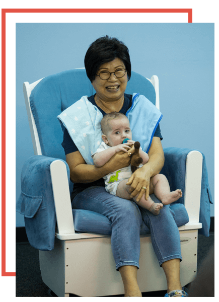 Volunteer Holding Baby